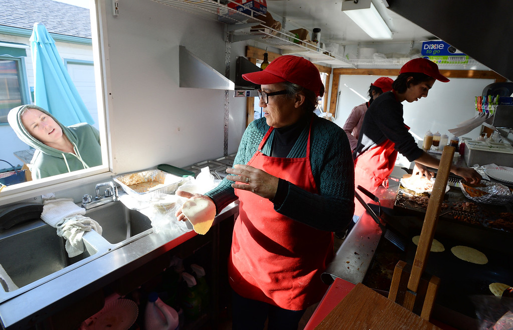 . BOULDER, CO - November 6, 2018: Veronica Diaz  talks to a regular from the food truck. Her son, Allan, works in the background. Tierra Y Fuego taco stand/Diaz Farm in Boulder is being reviewed.  (Photo by Cliff Grassmick/Staff Photographer)
