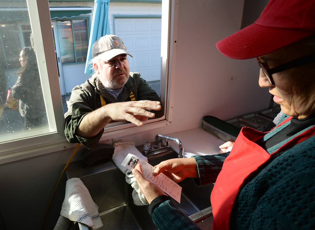 . BOULDER, CO - November 6, 2018: Pepe Diaz gives an order to his wife Veronica in the food truck. Tierra Y Fuego taco stand/Diaz Farm in Boulder is being reviewed.  (Photo by Cliff Grassmick/Staff Photographer)