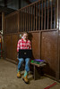"Minnetonka, MN - MTK_0113_School_Johnson - Bailey Johnson volunteers at We Can Ride at MN Home School. She does her homework during breaks at the stables as ""Fancy"" the horse looks on. Photo by © Todd Buchanan 2012 Technical Questions: todd@toddbuchanan.com; Phone: 612-226-5154."
