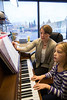 Plymouth, MN -PLM_0113_Virtuosos_Music_Academy - Beat the winter blah's by taking some music lessons at Virtuosos Music Academy - Nora Hagerty gets some help from Siri Caltvedt on the piano. and Miranda Rusch gets some guitar lessons from Mike Salow. Photo by © Todd Buchanan 2012 Technical Questions: todd@toddbuchanan.com; Phone: 612-226-5154.