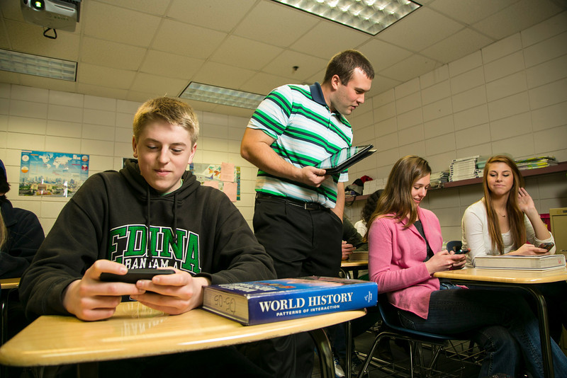 "Edina, MN - EDM_0313_2200_Dahlman - Brad Dahlman is a social studies teacher at Edina High School and his students are adapting to the school's new ""bring your own device"" program to use those devices in the classroom along with traditional books for their curriculum.  date: Monday January 7, 2013.  Photo by © Todd Buchanan 2013 Technical Questions: todd@toddbuchanan.com; Phone: 612-226-5154."