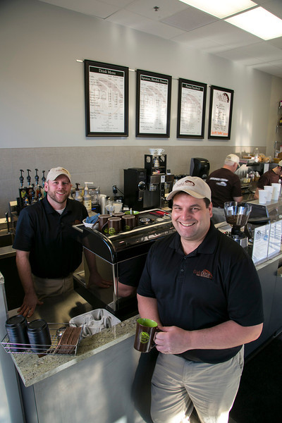 Maple Grove, MN - MGM_0313_2245_Daily_Dose: Ben Havn and Curt are co-owners of the Daily Dose coffee shop in Maple Grove, MN with some of their products. date: Tuesday January 15, 2013.  Photo by © Todd Buchanan 2013 Technical Questions: todd@toddbuchanan.com; Phone: 612-226-5154.