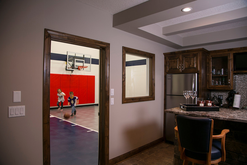 Maple Grove, MN - MGM_0313_2248_Trubeck - Bill and Sandrene Trubeck have an indoor basketballl court in their home that is right off their basement bar. Their Children, Elizabeth, 9, and Billy, 7, play basketball on the court.  date: Tuesday January 8, 2013.  Photo by © Todd Buchanan 2013 Technical Questions: todd@toddbuchanan.com; Phone: 612-226-5154.
