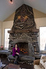 Minnetonka, MN -MTK_0313_2214_Cyr_Fireplace: Judy Cyr has a Fireplace built in her screened-in porch with a variety of features including lights, amethyst and even a dinosaur tooth as well as using re-used wood for the furniture. date: Tuesday January 15, 2013.  Photo by © Todd Buchanan 2013 Technical Questions: todd@toddbuchanan.com; Phone: 612-226-5154.