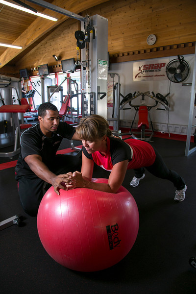 Chaska, MN - SWM 0912 Fitness2 Jay Hancock - Tiger Oak - Jay Hancock of Snap Fitness in Chaska works with Rena Hall on her work out at the studio. Photo by © Todd Buchanan 2012 Technical Questions: todd@toddbuchanan.com;