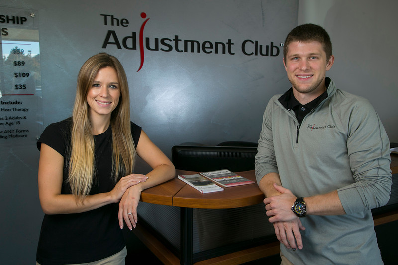 Maple Grove, MN - MPG3239 Adjustment Club - Brad Giffore:  Brad Giffore of the Adjustment Club at his new offices in Maple Grove with his fiancee Alyssa Kukowski here today, Wednesday October 16, 2013. Photo by © Todd Buchanan 2013 Technical Questions: todd@toddbuchanan.com; Phone: 612-226-5154.
