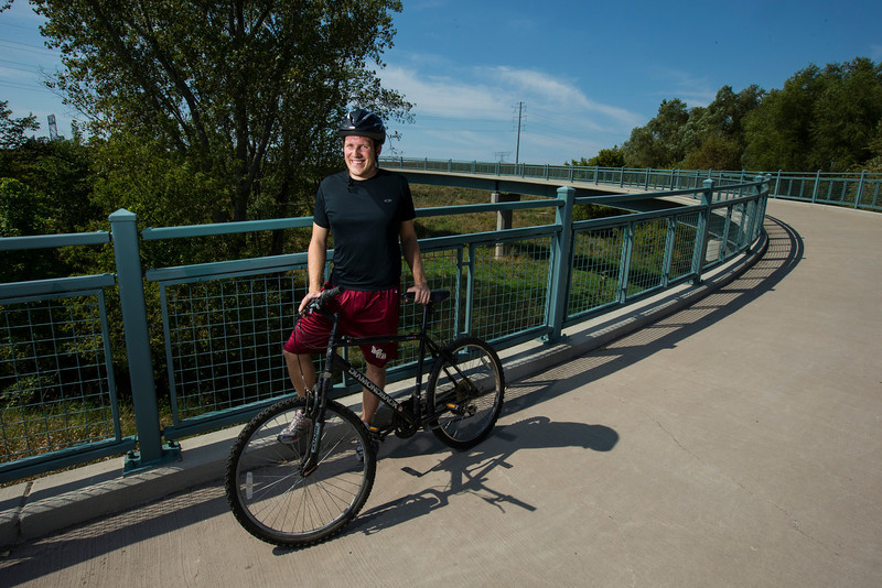 Maple Grove, MN - MGM 1112 - Author Andy Greder talks about biking on the trails around Maple Grove where he grew up. 1st location with author - Bridge over County Road 81 near  Elm Creek Park Preserve - 2nd Location Rice Lake overlook, Location 3 mature Groves of Maples - Location 4 Fish Lake Regional Park. Photo by © Todd Buchanan 2012 Technical Questions: todd@toddbuchanan.com;