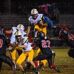 Desmond Ridder (9) leapt over a teammate.