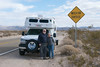 La Tortuga poses with a Tortoise sign in Death Valley, California