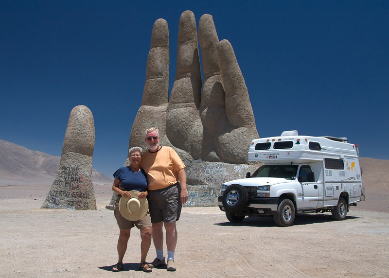 By a famous roadside sculpture in the Chilean desert