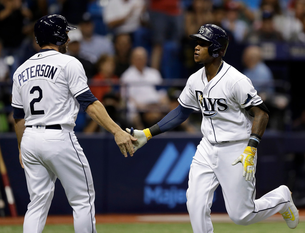 . Tampa Bay Rays\' Tim Beckham shakes hands with Shane Peterson (2) after Beckham hit a two-run home run off Detroit Tigers starting pitcher Michael Fulmer during the third inning of a baseball game Tuesday, April 18, 2017, in St. Petersburg, Fla. (AP Photo/Chris O\'Meara)