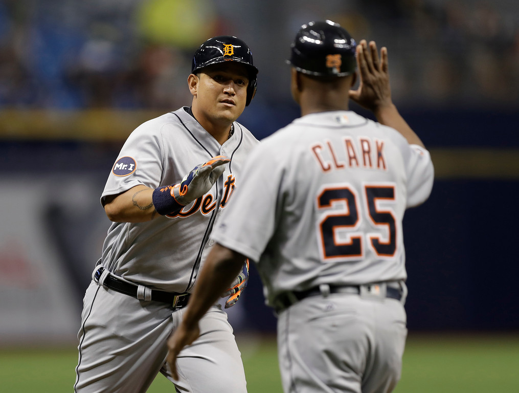 . Detroit Tigers\' Miguel Cabrera high fives third base coach Dave Clark (25) after his home run off Tampa Bay Rays starting pitcher Matt Andriese during the first inning of a baseball game Tuesday, April 18, 2017, in St. Petersburg, Fla. (AP Photo/Chris O\'Meara)