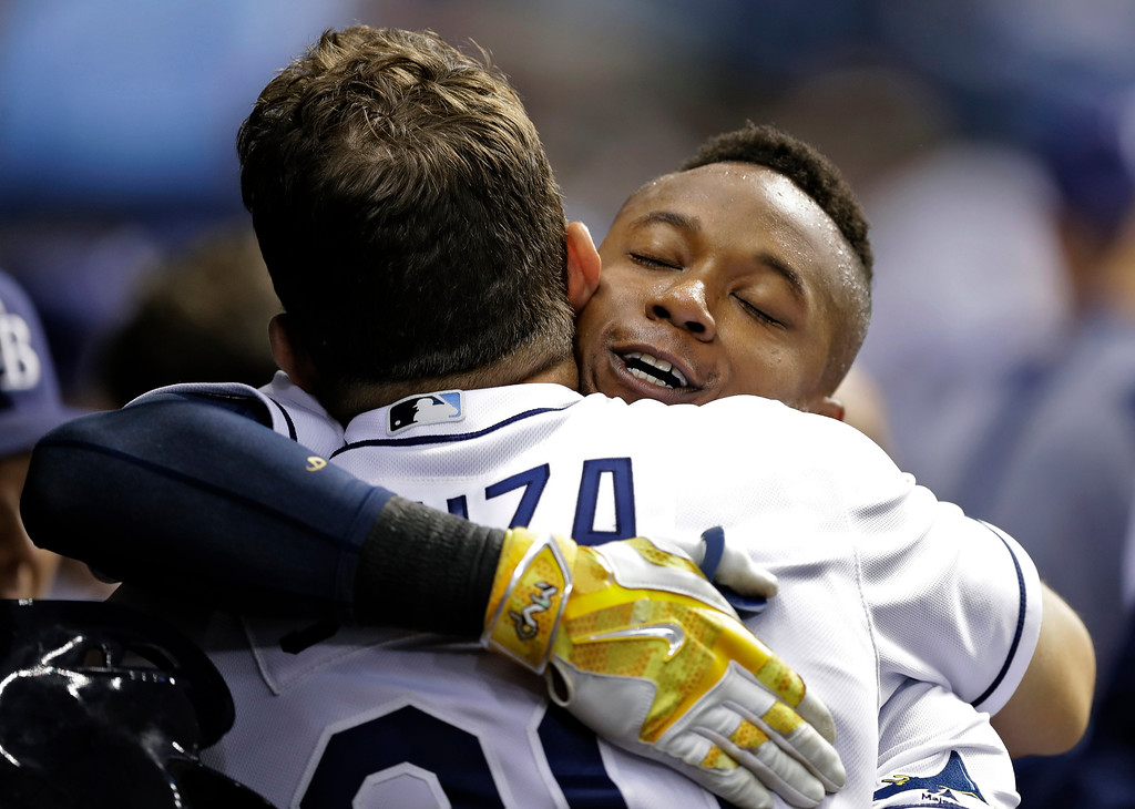 . Tampa Bay Rays\' Tim Beckham, right, hugs Steven Souza Jr. in the dugout after Beckham hit a two-run home run off Detroit Tigers starting pitcher Michael Fulmer during the third inning of a baseball game Tuesday, April 18, 2017, in St. Petersburg, Fla. (AP Photo/Chris O\'Meara)