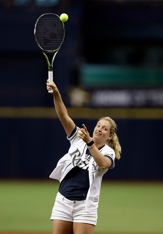 . USTA Fed Cup tennis player CoCo Vandeweghe serves the ceremonial first pitch before a baseball game between the Tampa Bay Rays and the Detroit Tigers on Tuesday, April 18, 2017, in St. Petersburg, Fla. (AP Photo/Chris O\'Meara)