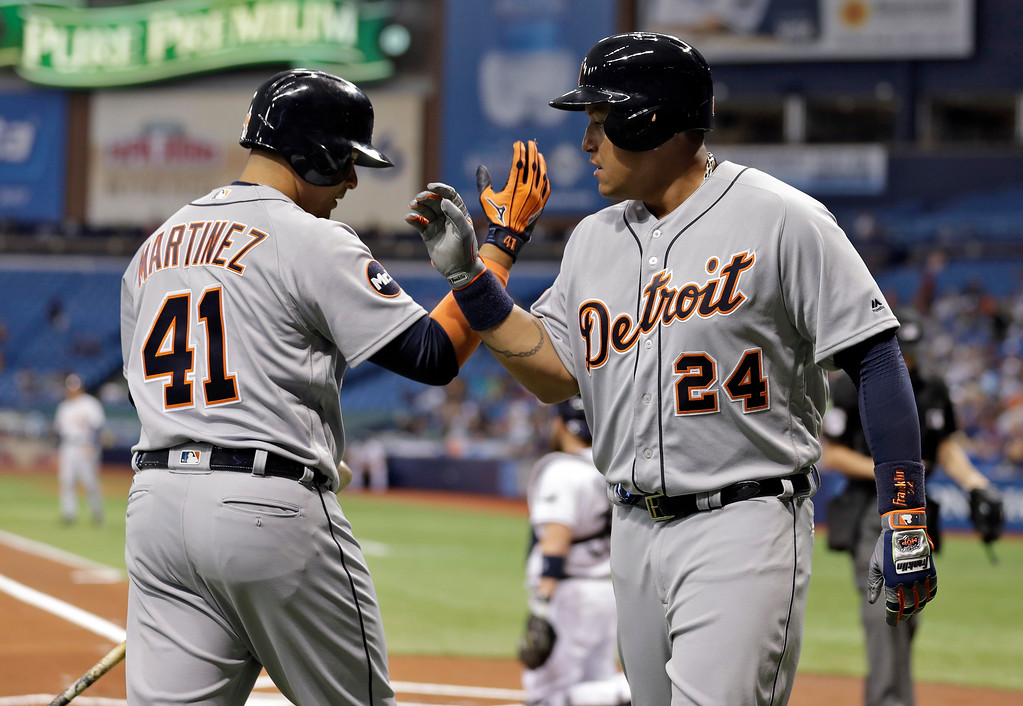 . Detroit Tigers\' Miguel Cabrera (24) celebrates with on-deck batter Victor Martinez (41) after Cabrera hit a home run off Tampa Bay Rays starting pitcher Matt Andriese during the first inning of a baseball game Tuesday, April 18, 2017, in St. Petersburg, Fla. (AP Photo/Chris O\'Meara)