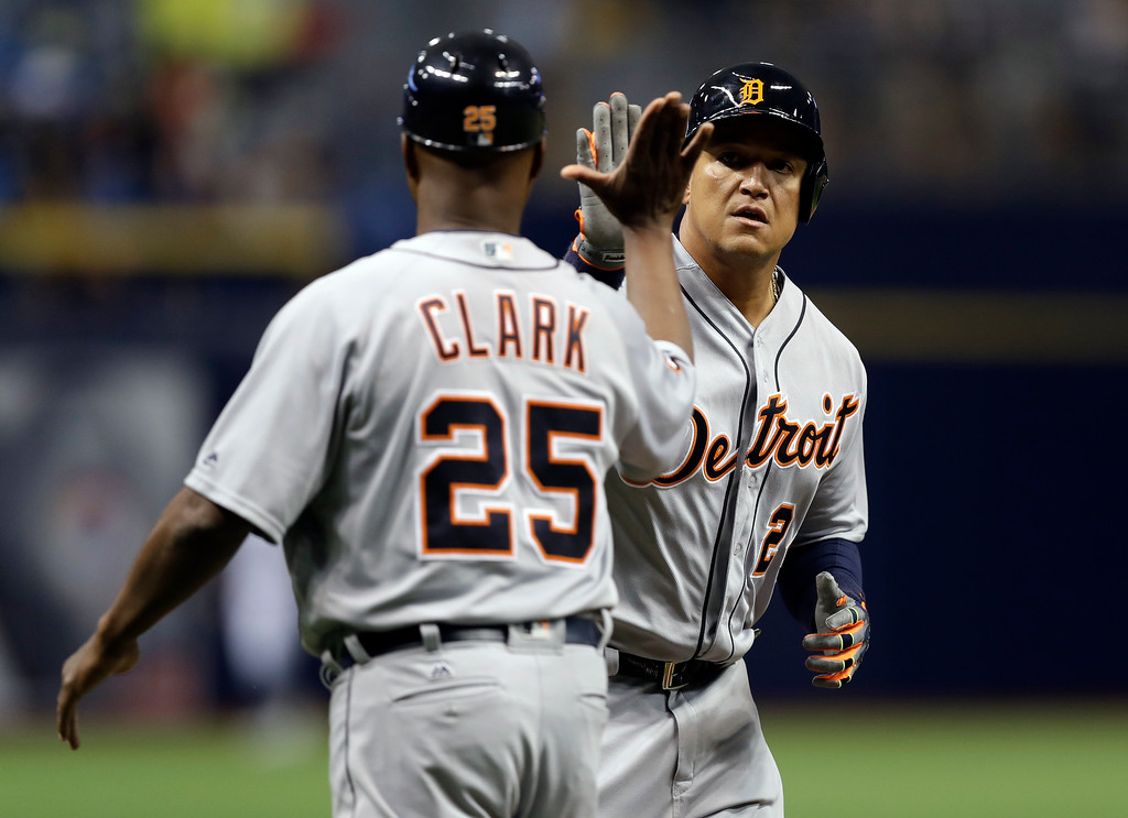 . Detroit Tigers\' Miguel Cabrera high fives third base coach Dave Clark (25) after hitting a home run off Tampa Bay Rays starting pitcher Matt Andriese during the first inning of a baseball game Tuesday, April 18, 2017, in St. Petersburg, Fla. (AP Photo/Chris O\'Meara)