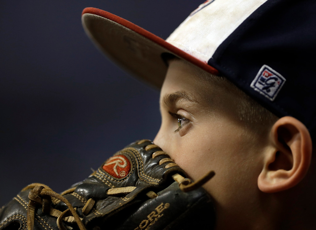. Nine-year-old Bryce Knight watches during the fourth inning of a baseball game between the Tampa Bay Rays and the Detroit Tigers on Wednesday, April 19, 2017, in St. Petersburg, Fla. (AP Photo/Chris O\'Meara)