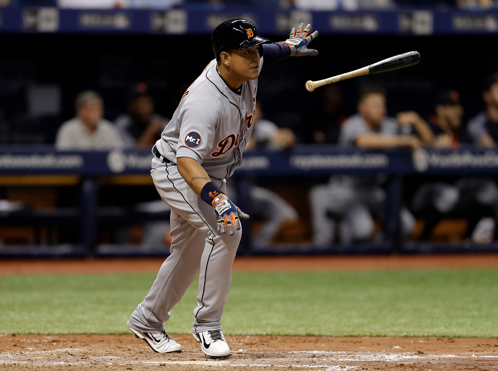 . Detroit Tigers\' Miguel Cabrera (24) flips his bat after hitting an RBI double off Tampa Bay Rays starting pitcher Chris Archer during the fifth inning of a baseball game Wednesday, April 19, 2017, in St. Petersburg, Fla. Tigers\' Jose Iglesias scored. (AP Photo/Chris O\'Meara)