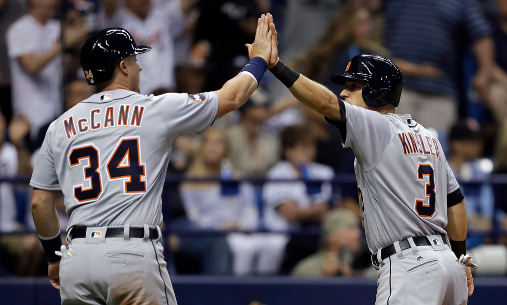. Detroit Tigers\' Ian Kinsler (3) and James McCann celebrate after scoring on a three-run triple by Nicholas Castellanos off Tampa Bay Rays relief pitcher Jumbo Diaz during the sixth inning of a baseball game Wednesday, April 19, 2017, in St. Petersburg, Fla. (AP Photo/Chris O\'Meara)