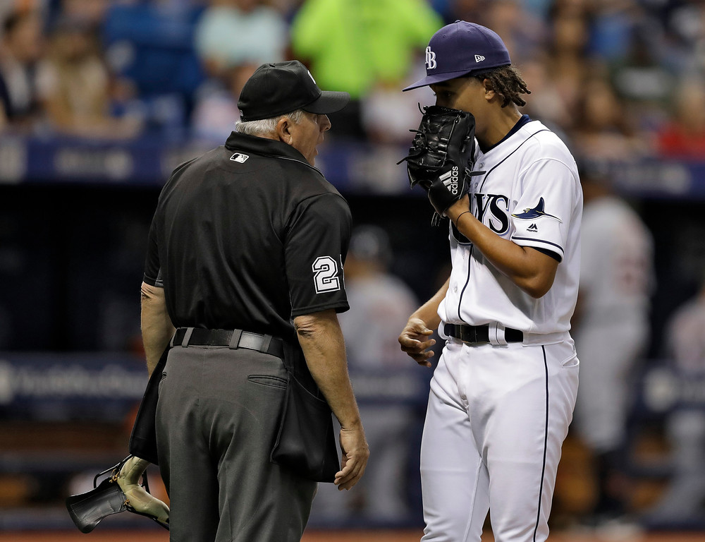 . Tampa Bay Rays starting pitcher Chris Archer talks to home plate umpire Larry Vanover during the fifth inning of a baseball game against the Detroit Tigers Wednesday, April 19, 2017, in St. Petersburg, Fla. (AP Photo/Chris O\'Meara)