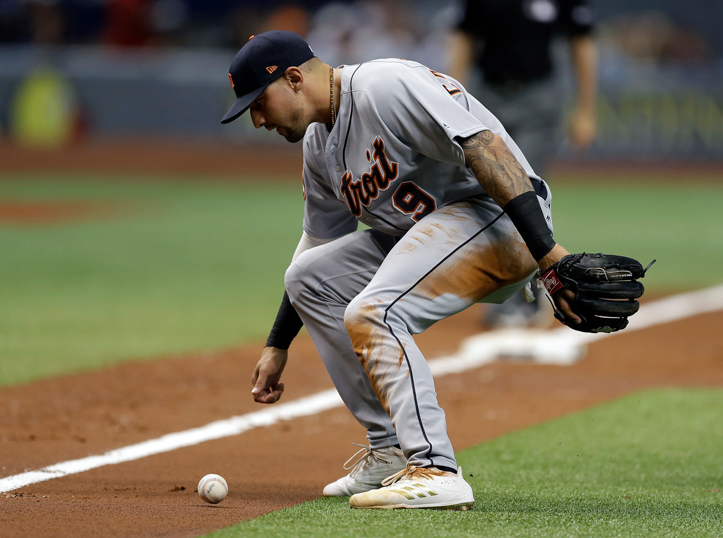 . Detroit Tigers third baseman Nicholas Castellanos watches a bunt by Tampa Bay Rays\' Kevin Kiermaier roll up the third base line during the first inning of a baseball game Wednesday, April 19, 2017, in St. Petersburg, Fla. The ball stayed fair. (AP Photo/Chris O\'Meara)
