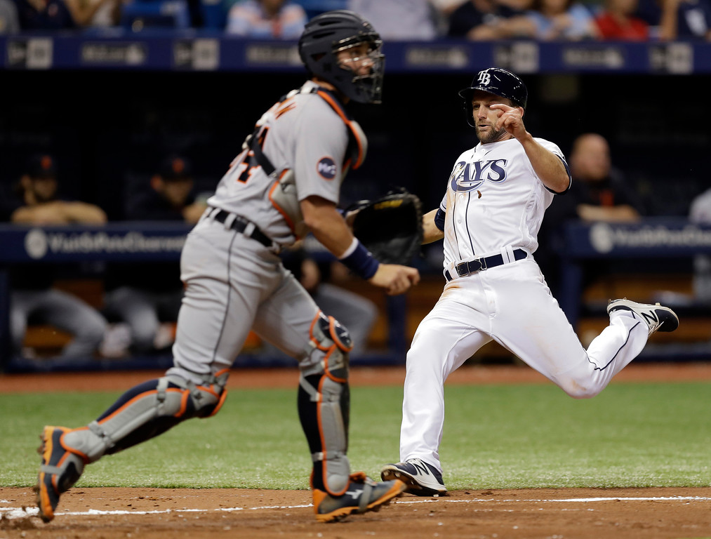 . Tampa Bay Rays\' Shane Peterson, right, scores ahead of the throw to Detroit Tigers catcher James McCann on an RBI single by Corey Dickerson off Tigers pitcher Jordan Zimmermann during the fourth inning of a baseball game Wednesday, April 19, 2017, in St. Petersburg, Fla. (AP Photo/Chris O\'Meara)