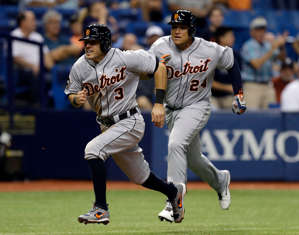 . Detroit Tigers\' Miguel Cabrera (24) nearly overruns Ian Kinsler as they both score on a two-run single by Victor Martinez during the fifth inning of a baseball game Wednesday, April 19, 2017, in St. Petersburg, Fla. (AP Photo/Chris O\'Meara)