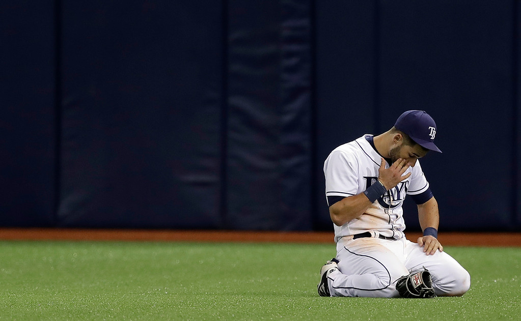 . Tampa Bay Rays center fielder Kevin Kiermaier reacts after misplaying a three-run triple by Detroit Tigers\' Nicholas Castellanos during the sixth inning of a baseball game Wednesday, April 19, 2017, in St. Petersburg, Fla. (AP Photo/Chris O\'Meara)