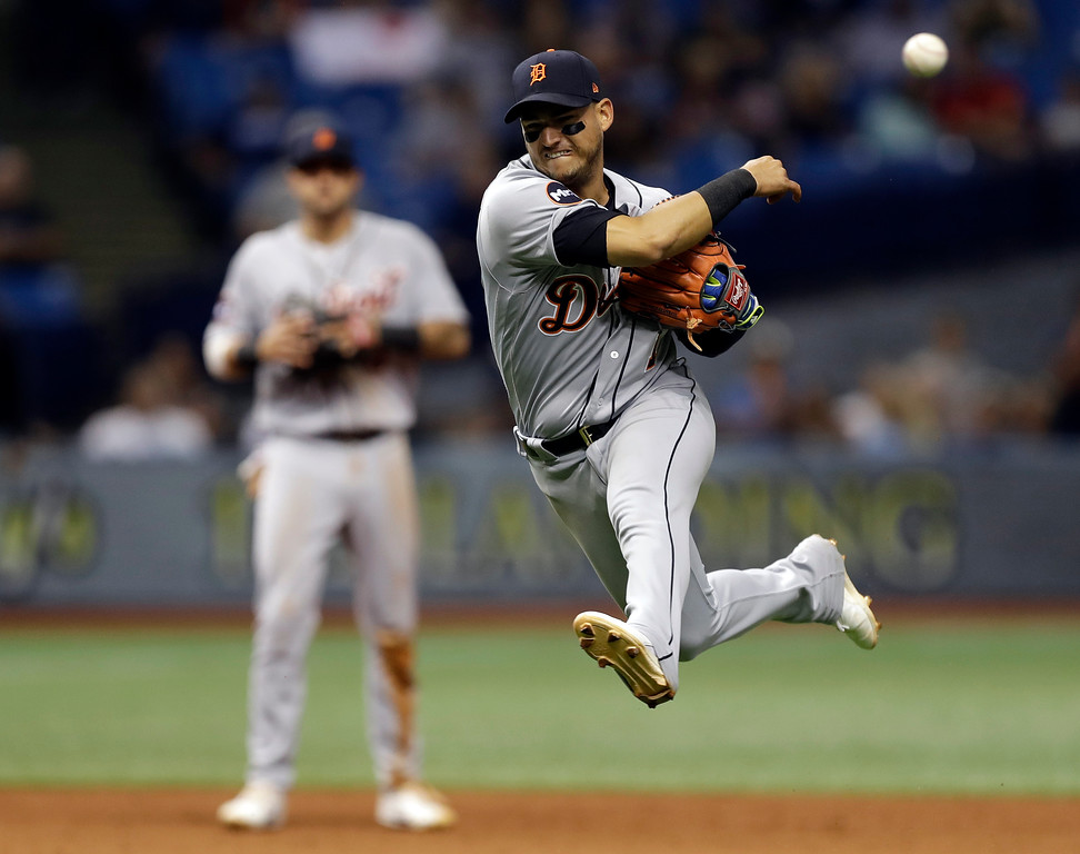 . Detroit Tigers shortstop Jose Iglesias leaves his feet as he throws out Tampa Bay Rays\' Derek Norris at first during the seventh inning of a baseball game Wednesday, April 19, 2017, in St. Petersburg, Fla. (AP Photo/Chris O\'Meara)