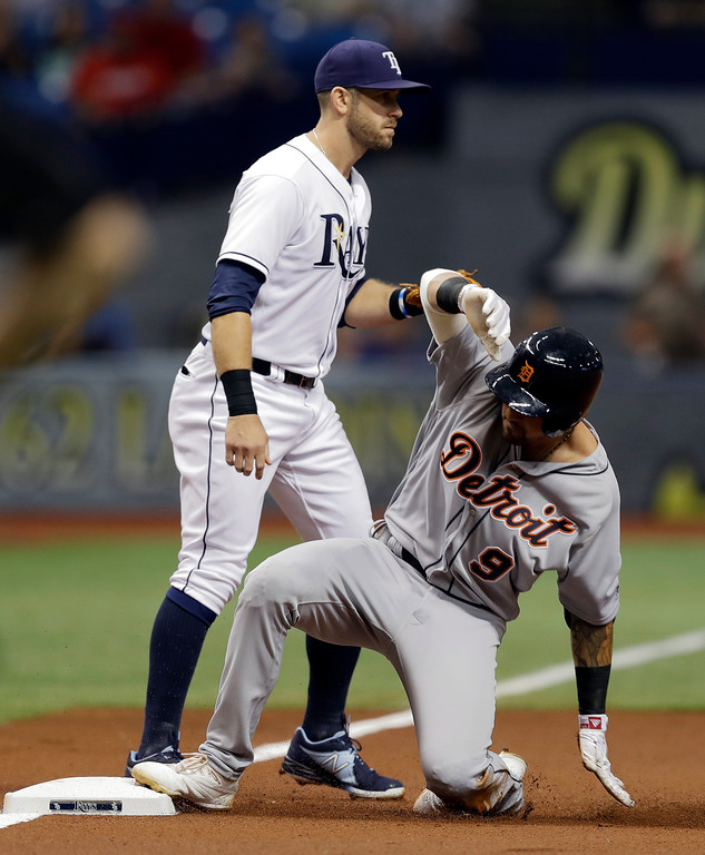 . Detroit Tigers\' Nicholas Castellanos (9) slides into third base with a triple ahead of the throw to Tampa Bay Rays\' Evan Longoria during the first inning of a baseball game Wednesday, April 19, 2017, in St. Petersburg, Fla. (AP Photo/Chris O\'Meara)