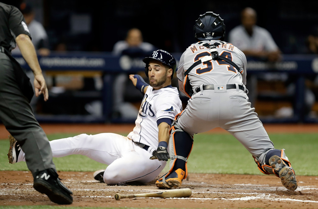 . Tampa Bay Rays\' Kevin Kiermaier reaches around the tag by Detroit Tigers catcher James McCann (34) to score on a two-run single by Evan Longoria off Tigers pitcher Jordan Zimmermann during the fourth inning of a baseball game Wednesday, April 19, 2017, in St. Petersburg, Fla. (AP Photo/Chris O\'Meara)