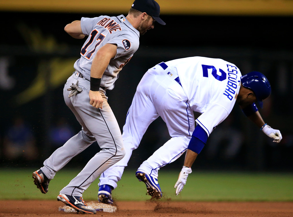 . Detroit Tigers second baseman Andrew Romine (17) tags out Kansas City Royals Alcides Escobar (2) during the fourth inning of a baseball game at Kauffman Stadium in Kansas City, Mo., Wednesday, May 31, 2017. (AP Photo/Orlin Wagner)