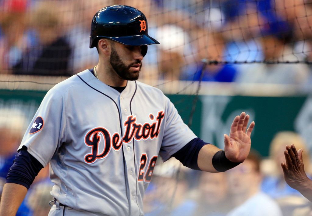 . Detroit Tigers\' J.D. Martinez is congratulated after scoring on a double by Justin Upton during the third inning of a baseball game against the Kansas City Royals at Kauffman Stadium in Kansas City, Mo., Wednesday, May 31, 2017. Martinez drove in two runs in the inning. (AP Photo/Orlin Wagner)