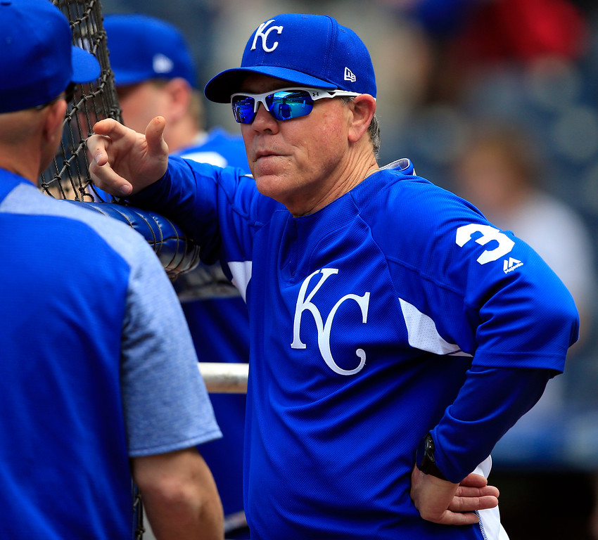 . Kansas City Royals manager Ned Yost talks with coaches during batting practice before a baseball game against the Detroit Tigers at Kauffman Stadium in Kansas City, Mo., Wednesday, May 31, 2017. (AP Photo/Orlin Wagner)