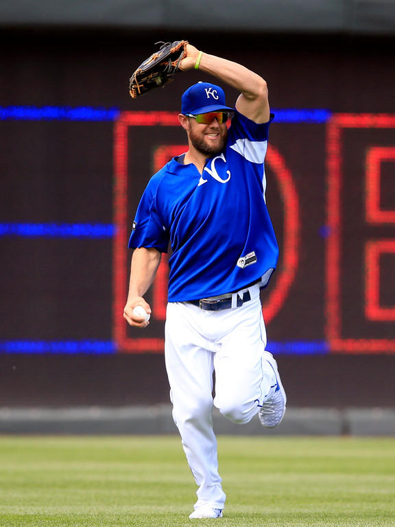 . Kansas City Royals left fielder Alex Gordon smiles while making a catch during batting practice before a baseball game against the Detroit Tigers at Kauffman Stadium in Kansas City, Mo., Wednesday, May 31, 2017. (AP Photo/Orlin Wagner)