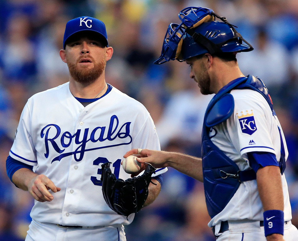 . Kansas City Royals catcher Drew Butera, right, hands a new ball to starting pitcher Ian Kennedy (31) during the third inning of a baseball game against the Detroit Tigers at Kauffman Stadium in Kansas City, Mo., Wednesday, May 31, 2017. (AP Photo/Orlin Wagner)