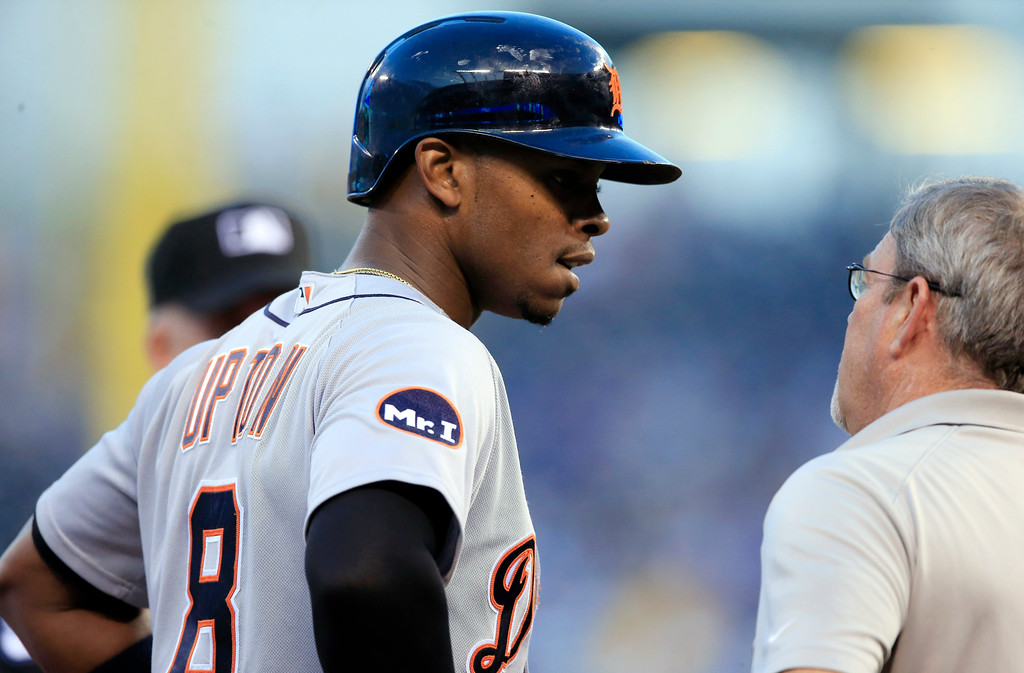 . Detroit Tigers\' Justin Upton (8) talks with a trainer before leaving the baseball game against the Kansas City Royals during the third inning in Kansas City, Mo., Wednesday, May 31, 2017. (AP Photo/Orlin Wagner)