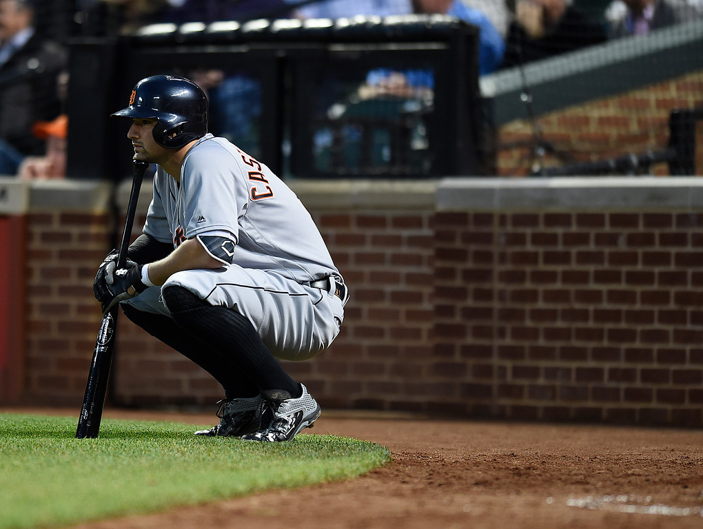 . Detroit Tigers\' Nick Castellanos squats on deck before playing the Baltimore Orioles in a baseball game, Thursday, May 12, 2016, in Baltimore. (AP Photo/Gail Burton)
