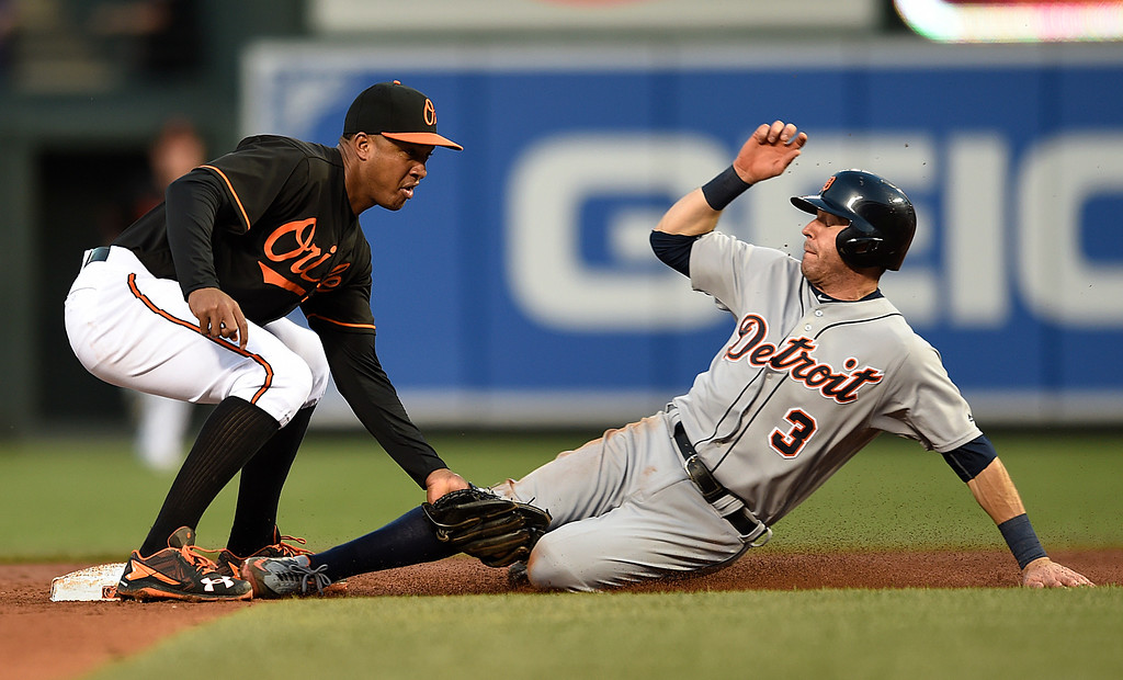 . Baltimore Orioles second baseman Jonathan Schoop tags out Detroit Tigers\' Ian Kinsler on a steal attempt in the third inning of a baseball game, Friday, May 13, 2016, in Baltimore. (AP Photo/Gail Burton)