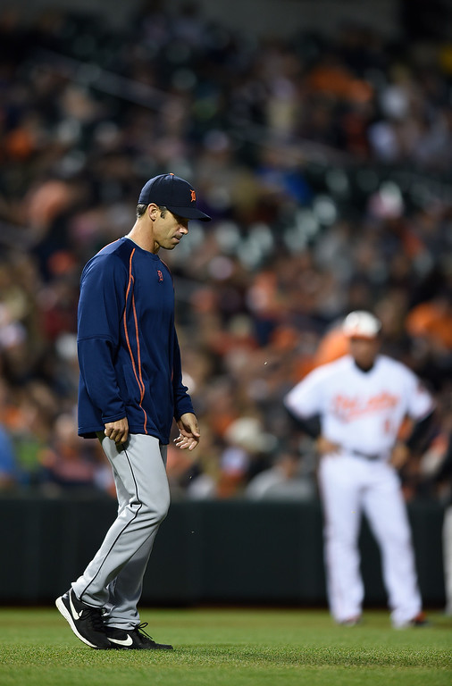 . Detroit Tigers manager Brad Ausmus walks onto the field to make a pitching change in a baseball game against the Baltimore Orioles, Thursday, May 12, 2016, in Baltimore. (AP Photo/Gail Burton)