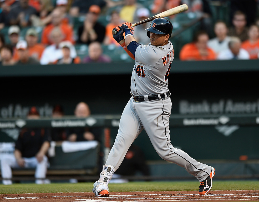 . Detroit Tigers\' Victor Martinez follows through on a single against the Baltimore Orioles in the first inning of a baseball game, Friday, May 13, 2016, in Baltimore. (AP Photo/Gail Burton)