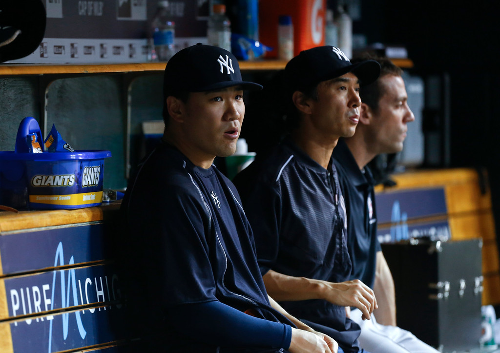 . New York Yankees pitcher Masahiro Tanaka watches from the dugout against the Detroit Tigers in the sixth inning of a baseball game in Detroit, Thursday, June 2, 2016. (AP Photo/Paul Sancya)