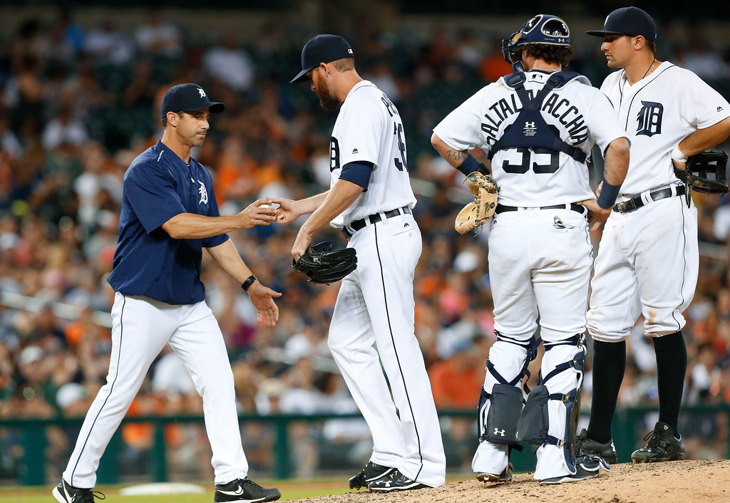 . Detroit Tigers manager Brad Ausmus takes the ball from relief pitcher Bobby Parnell against the New York Yankees in the seventh inning of a baseball game in Detroit, Thursday, June 2, 2016. (AP Photo/Paul Sancya)