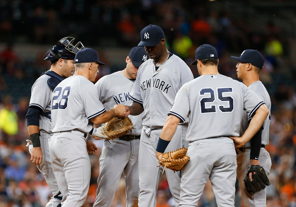 . New York Yankees manager Joe Girardi takes the ball from pitcher Michael Pineda during the sixth inning of a baseball game against the Detroit Tigers in Detroit, Thursday, June 2, 2016. (AP Photo/Paul Sancya)
