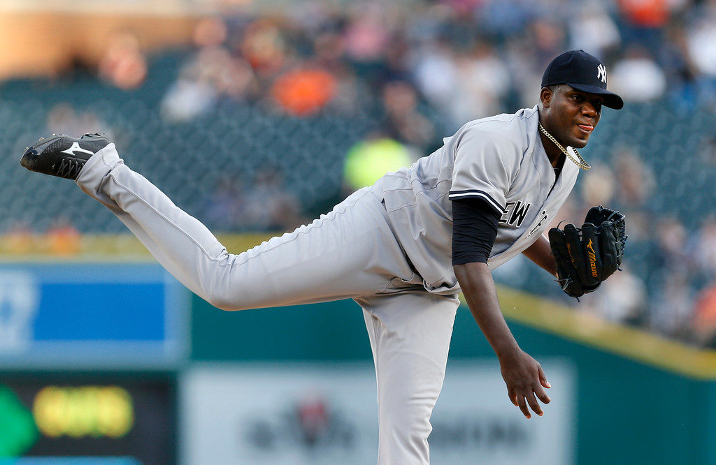 . New York Yankees pitcher Michael Pineda throws against the Detroit Tigers during the first inning of a baseball game in Detroit, Thursday, June 2, 2016. (AP Photo/Paul Sancya)