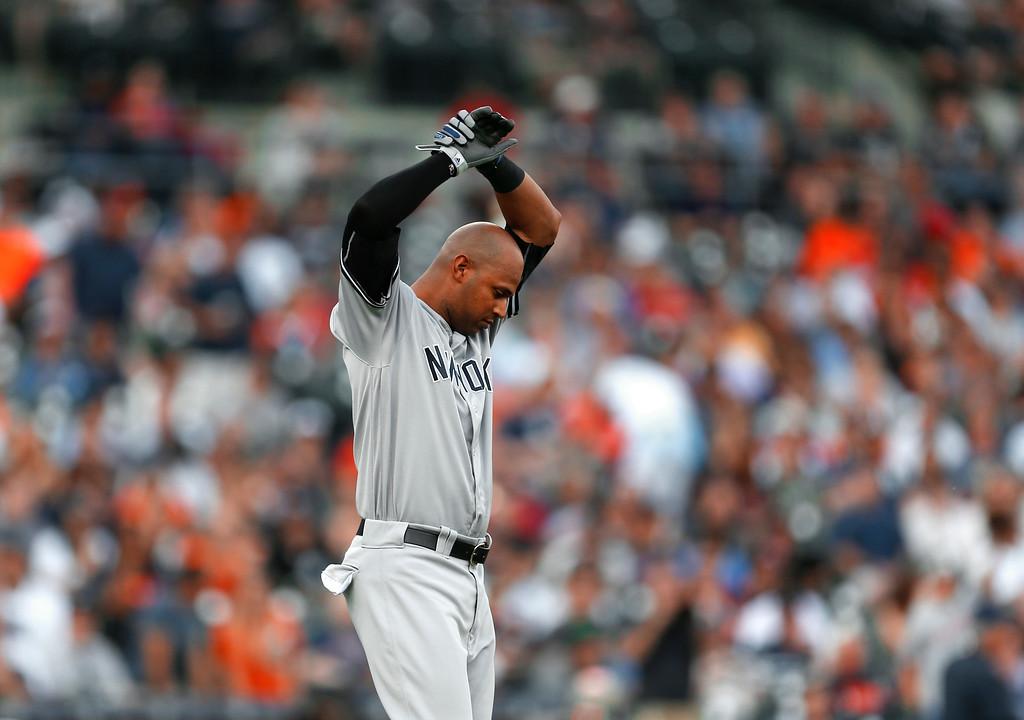 . New York Yankees\' Aaron Hicks reacts to striking out against the Detroit Tigers during the third inning of a baseball game in Detroit, Thursday, June 2, 2016. (AP Photo/Paul Sancya)