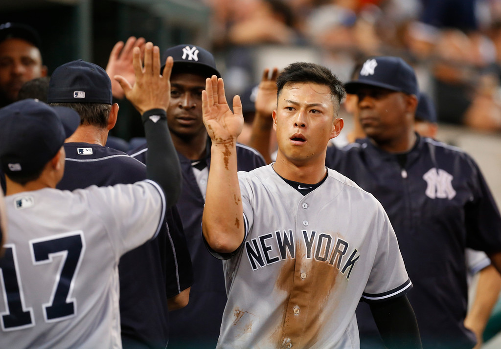 . New York Yankees\' Robert Refsnyder celebrates scoring on a sacrifice fly by Jacoby Ellsbury during the sixth inning of a baseball game against the Detroit Tigers in Detroit, Thursday, June 2, 2016. (AP Photo/Paul Sancya)