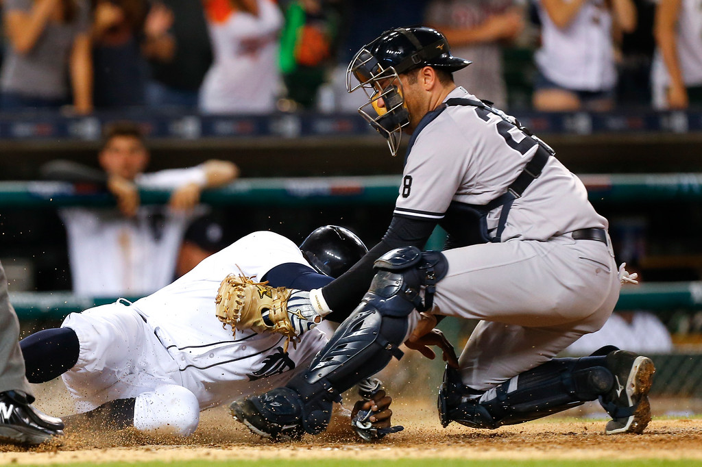 . New York Yankees catcher Austin Romine tags Detroit Tigers\' Justin Upton out at home plate on an Ian Kinsler double during the eighth inning of a baseball game in Detroit, Thursday, June 2, 2016. (AP Photo/Paul Sancya)
