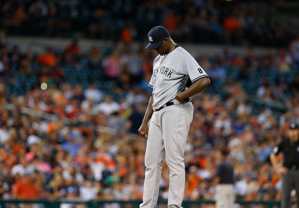 . New York Yankees pitcher Michael Pineda looks down before being relieved against the Detroit Tigers in the sixth inning of a baseball game in Detroit, Thursday, June 2, 2016. (AP Photo/Paul Sancya)