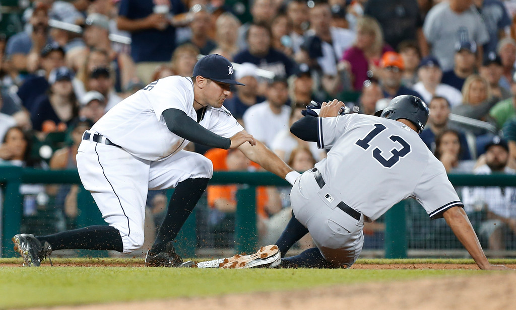 . Detroit Tigers third baseman Nick Castellanos tags New York Yankees\' Alex Rodriguez (13) out at third base on a force on a Austin Romine bunt in the seventh inning of a baseball game in Detroit, Thursday, June 2, 2016. (AP Photo/Paul Sancya)